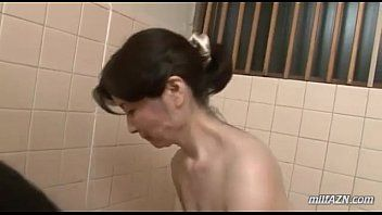 Aged woman washing youthful chap body engulfing his wang in the washroom