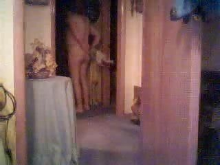 Milf undressing in daybed room. hidden web camera