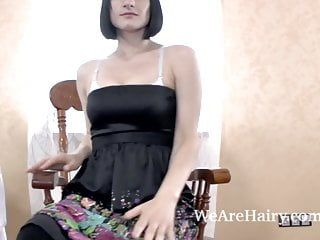 Alina h strips and masturbates on wooden chair